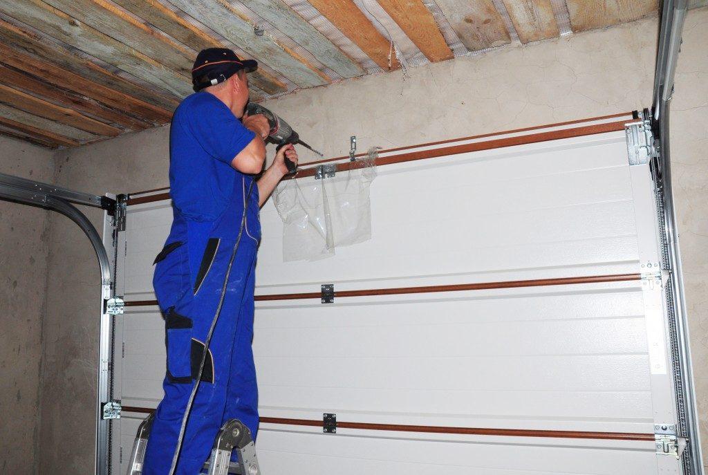 Contractor installing a garage door