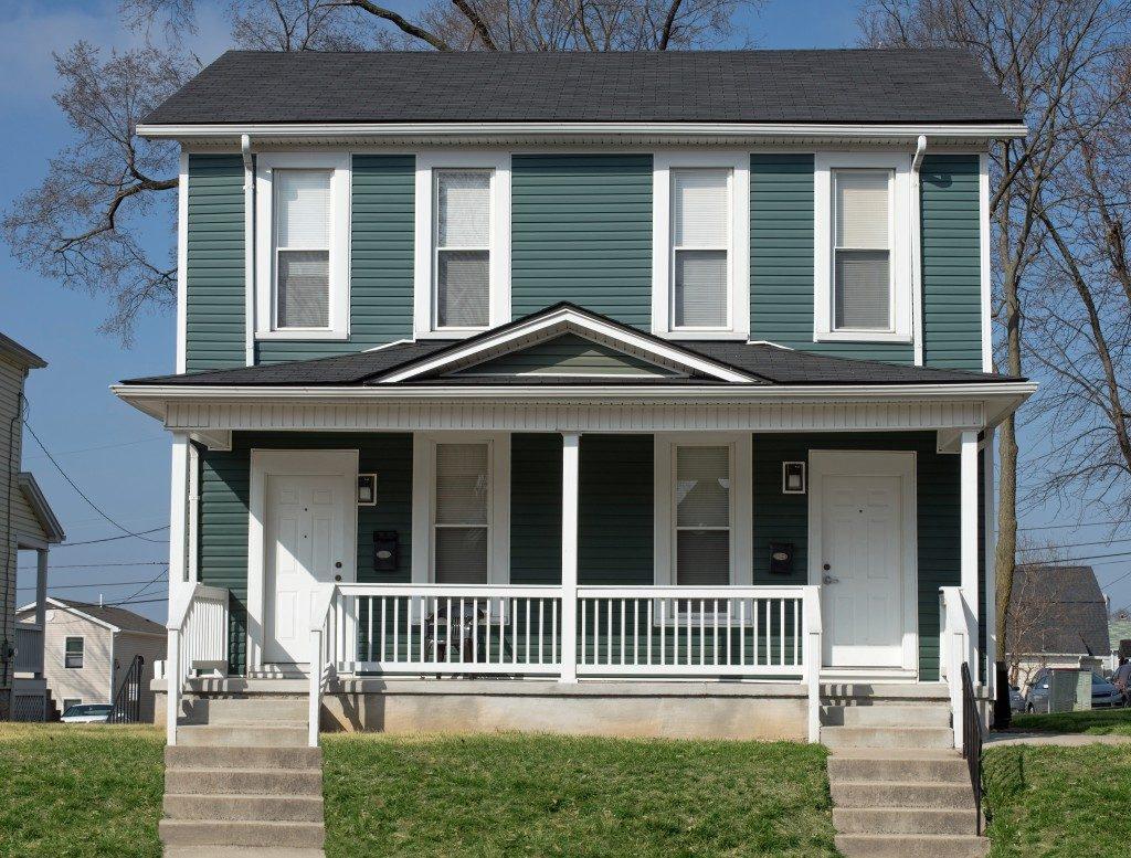 Dark green duplex home