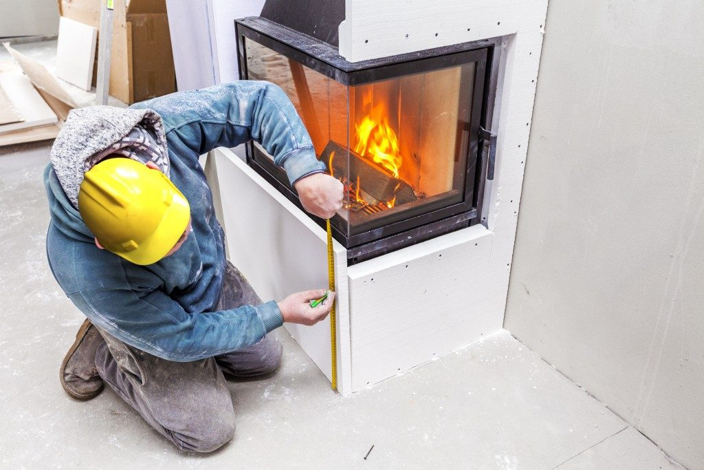 Man installing fireplace