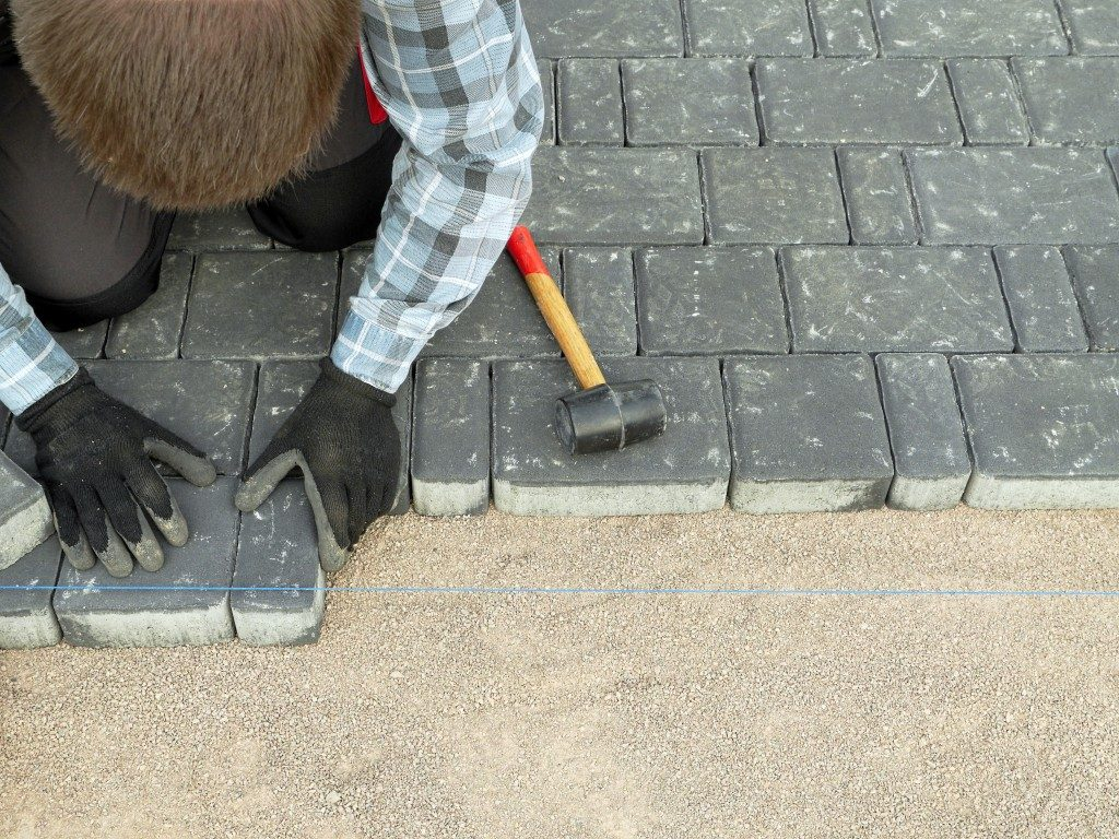 Paver laying driveway pavement out of concrete pavement blocks