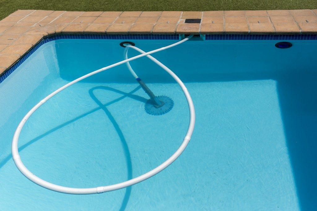 Underwater vacuum cleaner in action