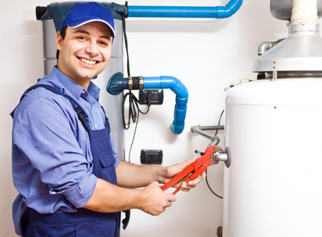 man doing maintenance on water heater
