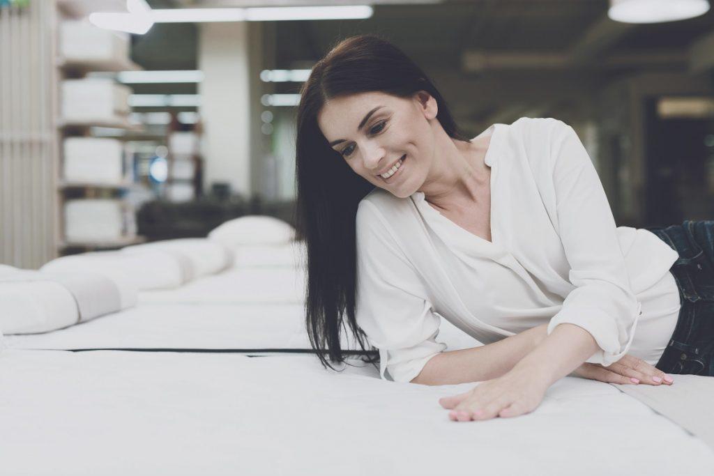 Woman trying the mattress