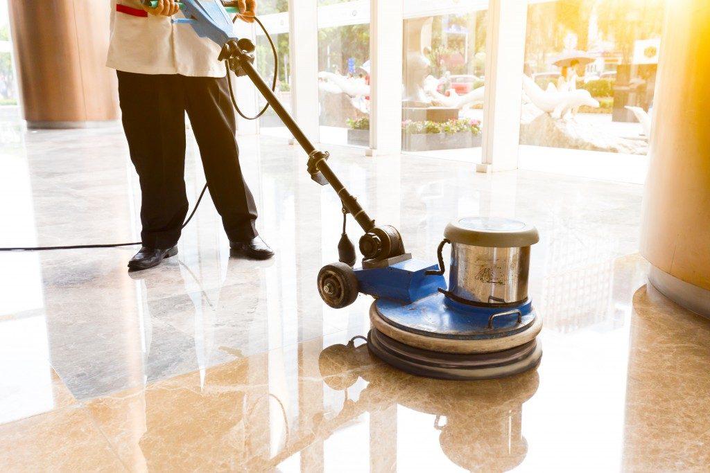 man cleaning floor tiles