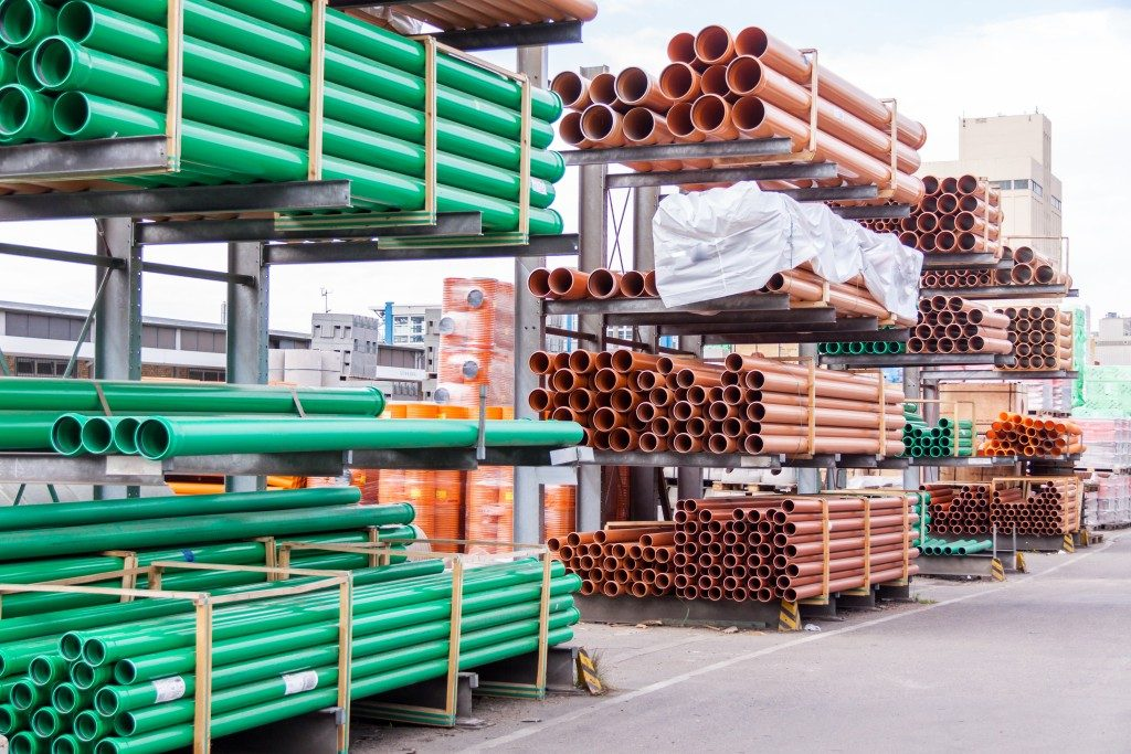 Plastic pipes stacked in a factory