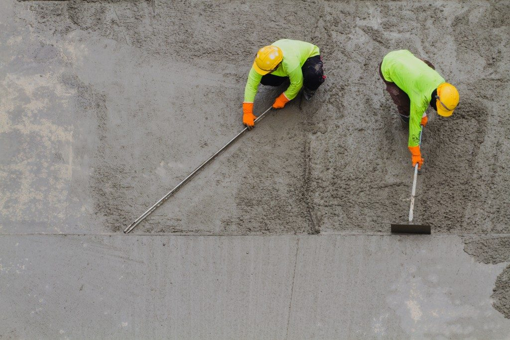 concrete being brushed evenly