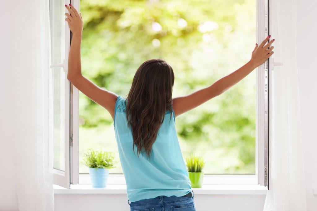 Woman opening the windows
