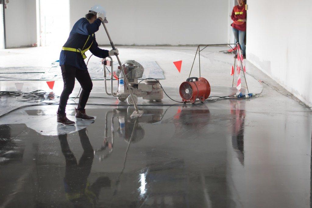 Man polishing concrete floor