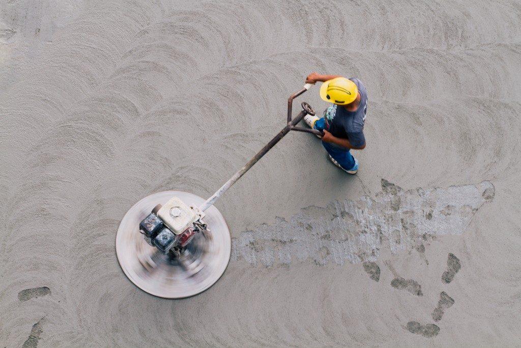 Man working on concrete flooring