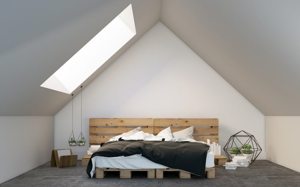 bed in wooden bedframe in the attic
