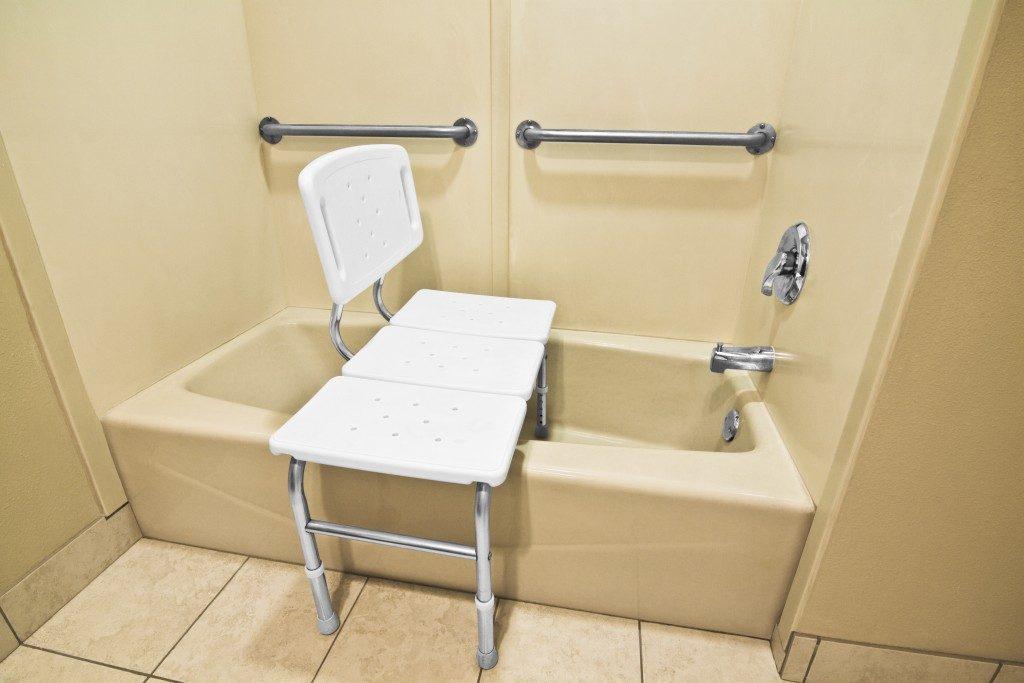 Bathing chair on a bathtub