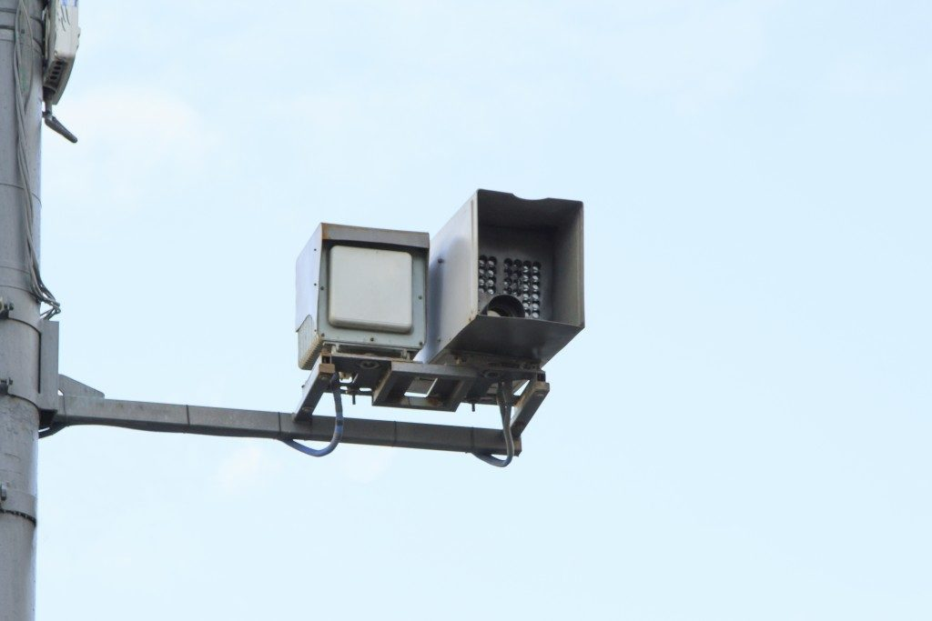 surveillance camera attached to a pole
