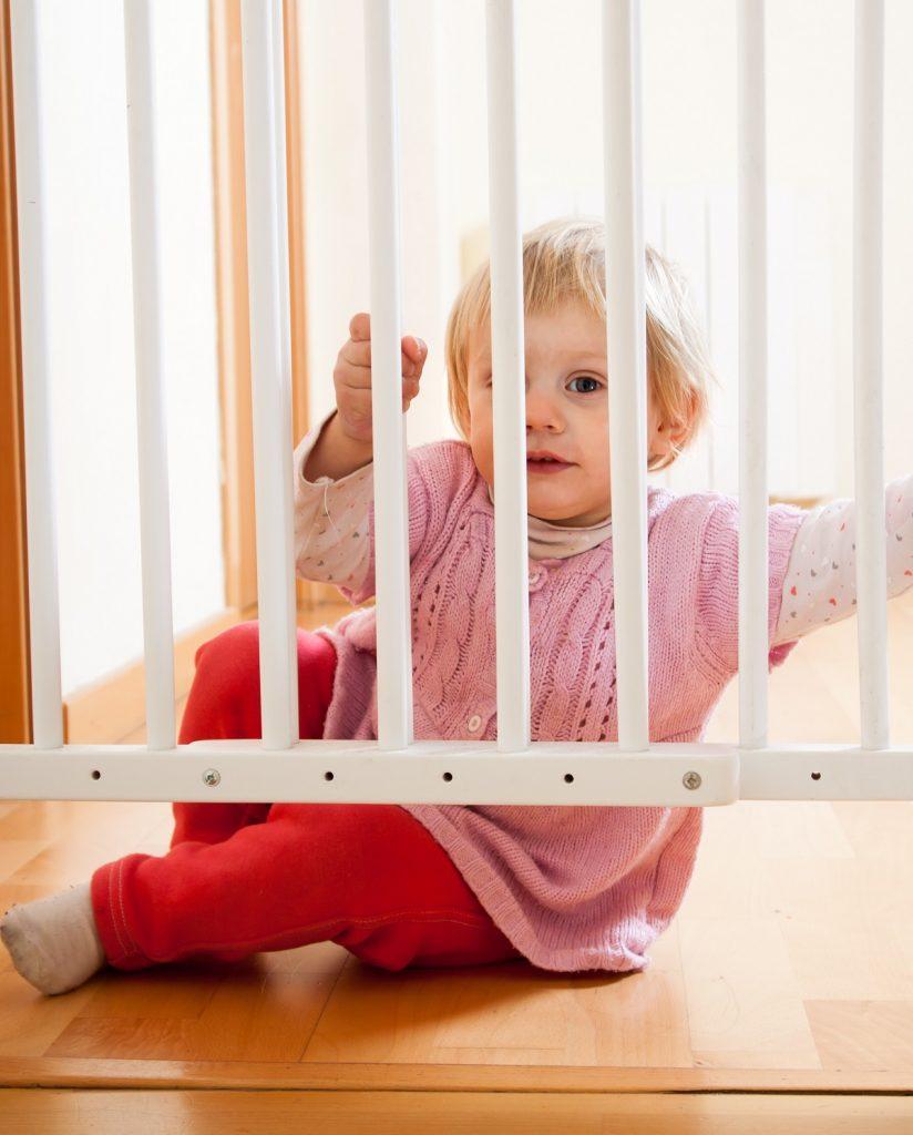 Baby behind safety gate