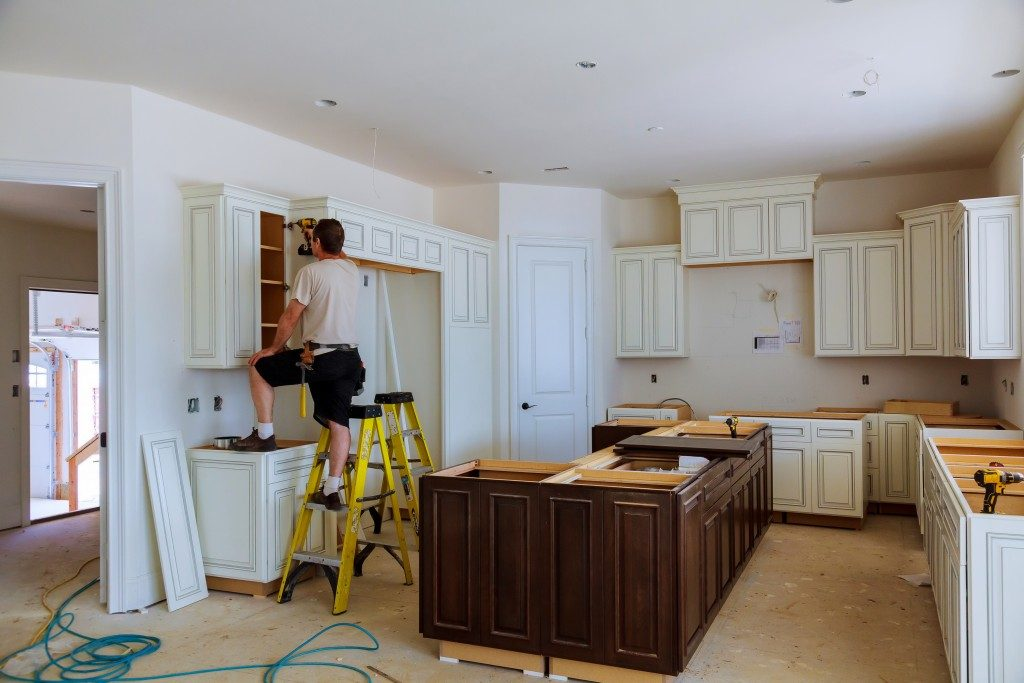 Repairing the kitchen cabinets