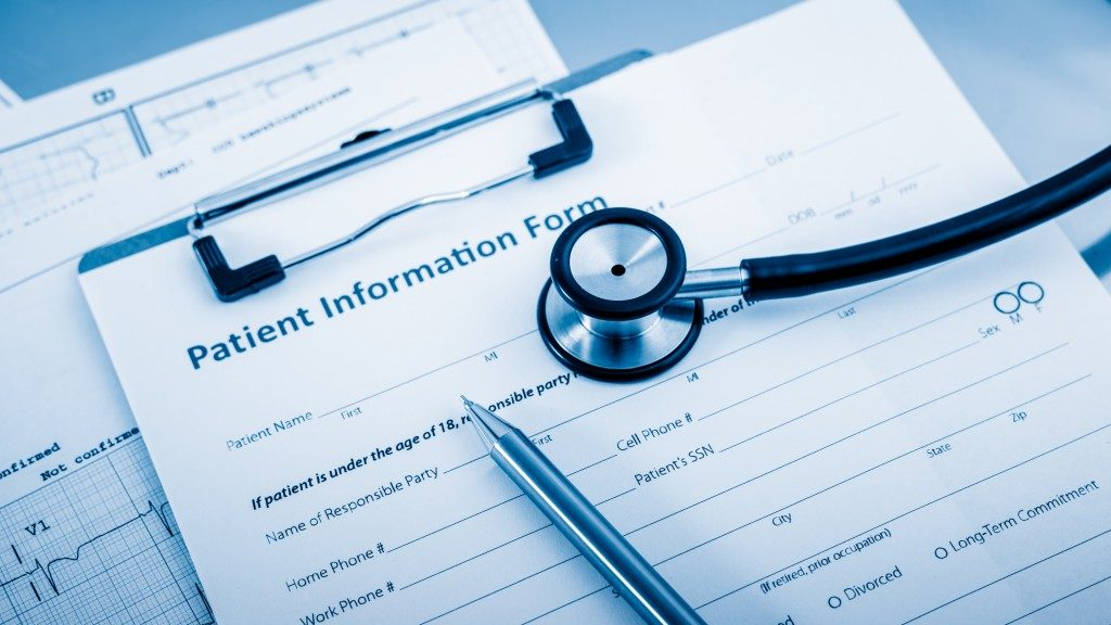 pen and stethoscope on top pf patient information form