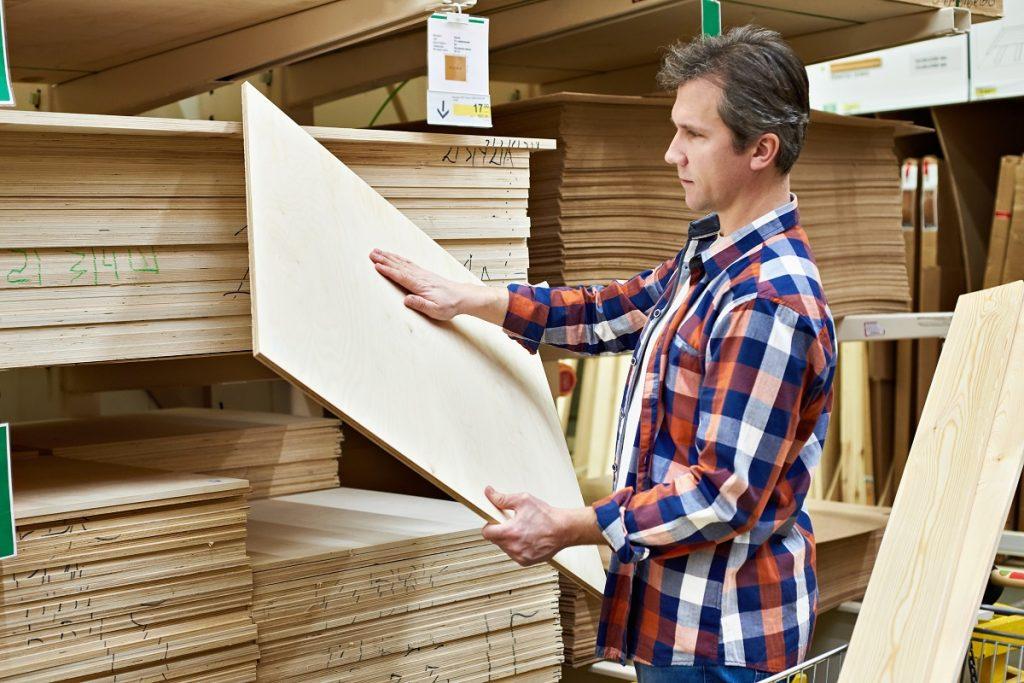 man buying a plywood