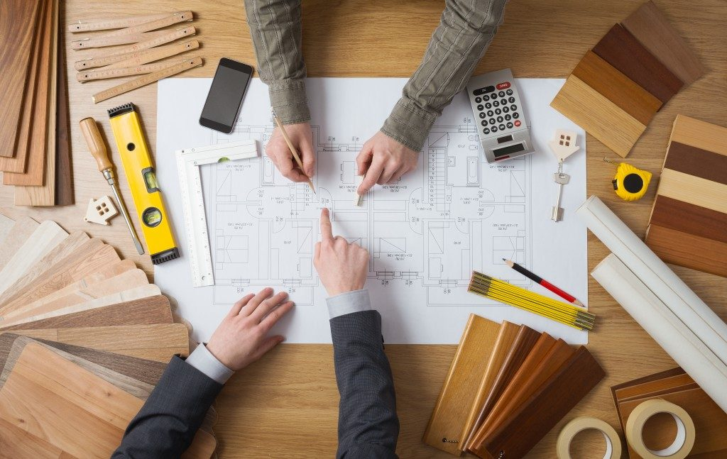 Engineers making a blueprint