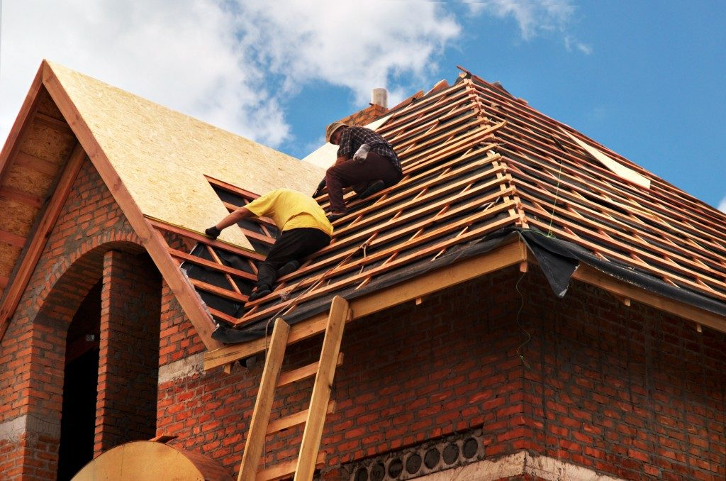 men building a roof