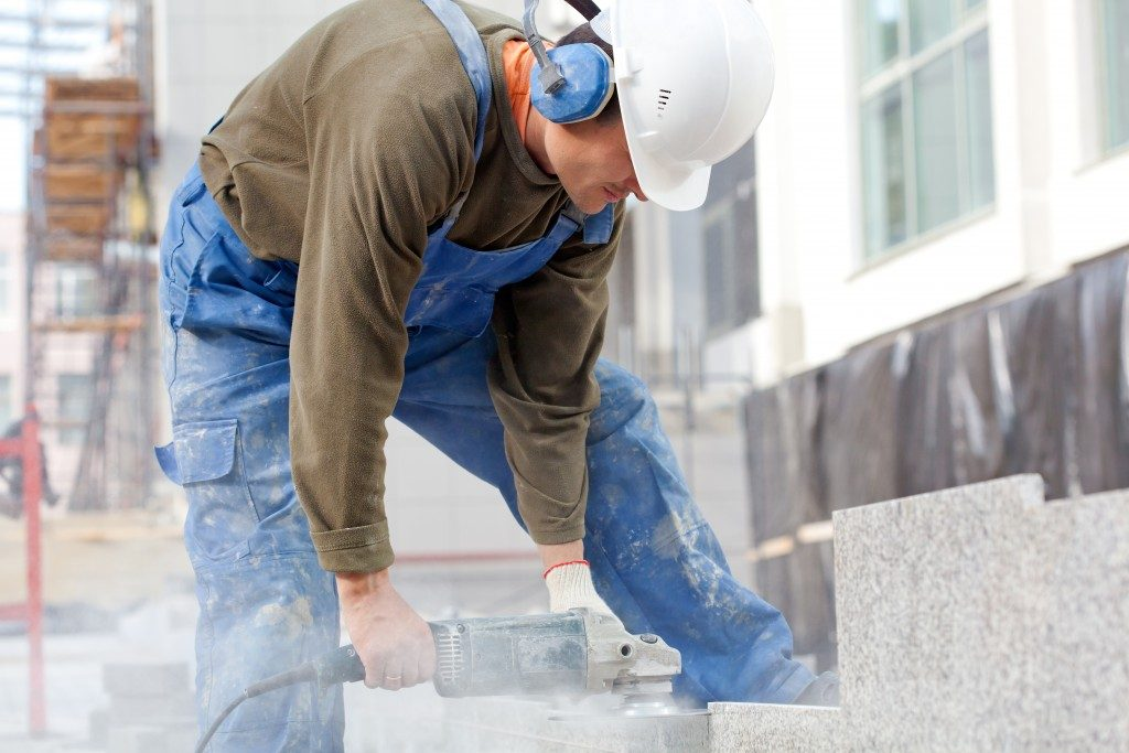 construction worker polishing concrete