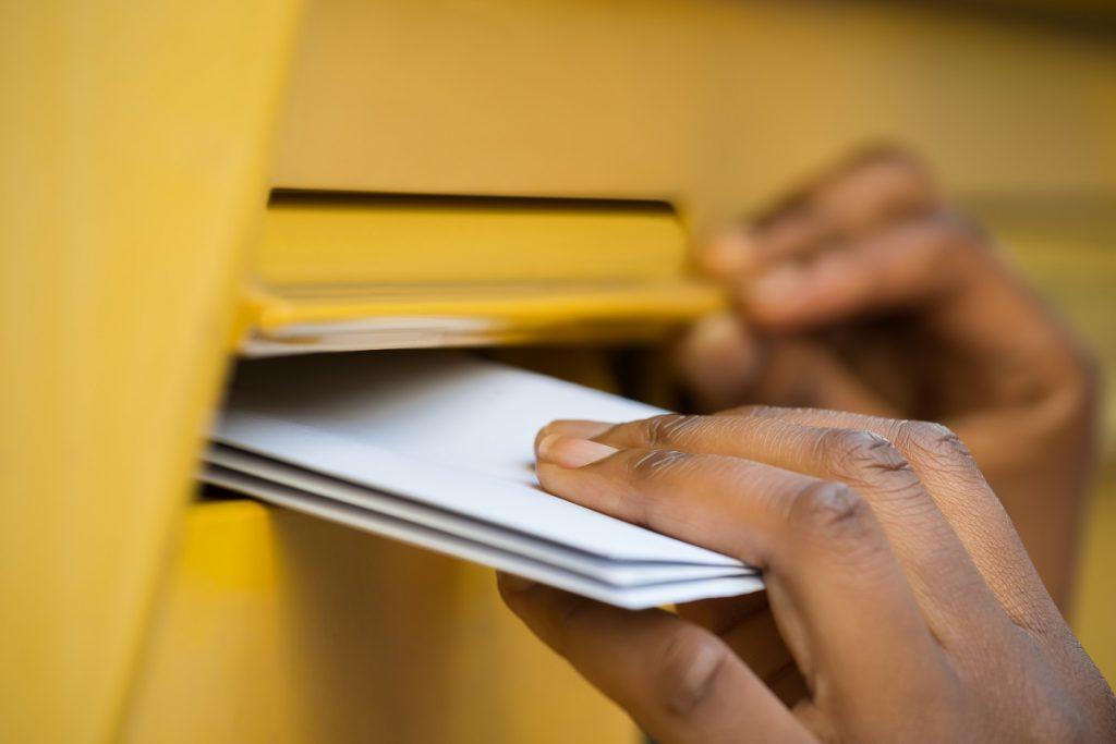 person sending postal letters