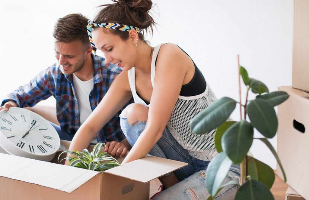couple unpacking their thing in their new apartment