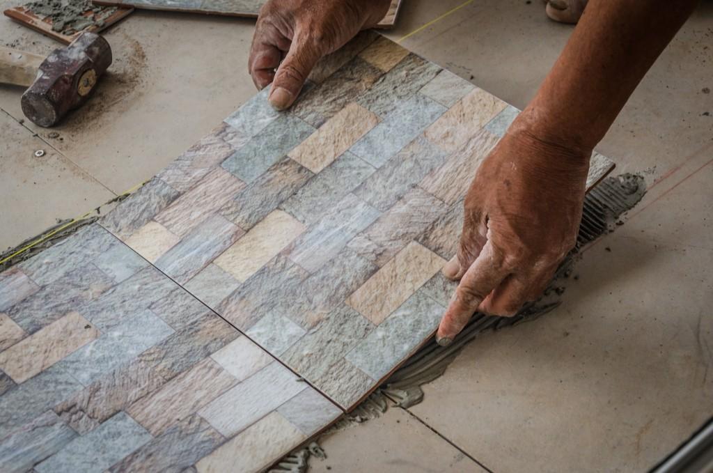 placing tile on floor