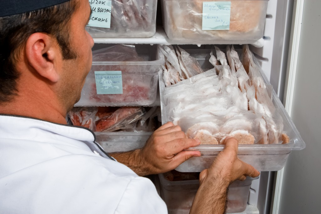 organizing food in the freezer