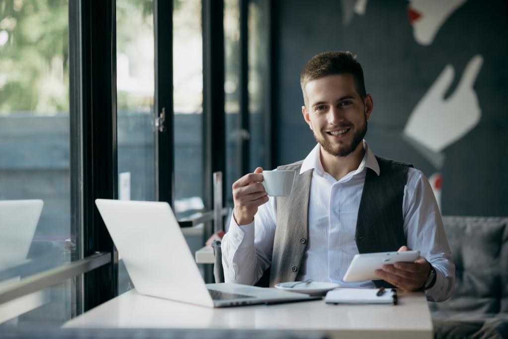 man working next to a window