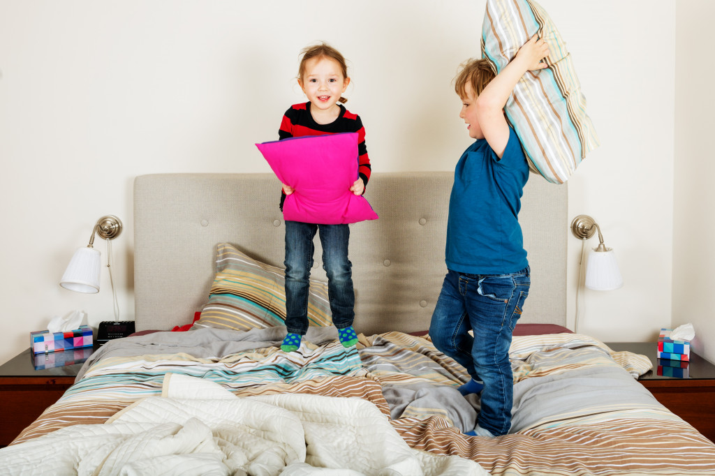 children playing in bed
