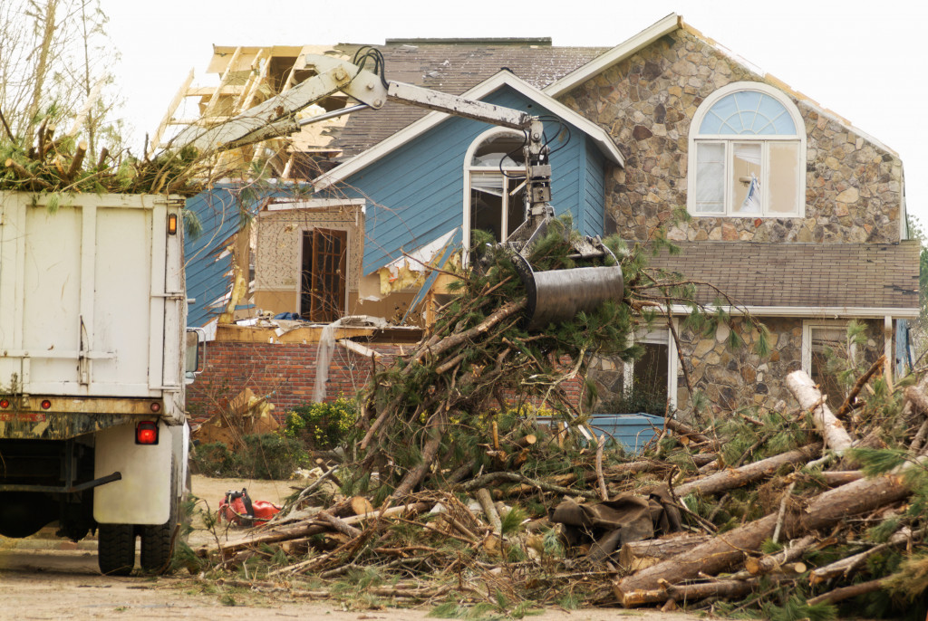 house hit badly by natural disaster